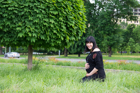 natural childbirth: The pregnant girl on walk in city park