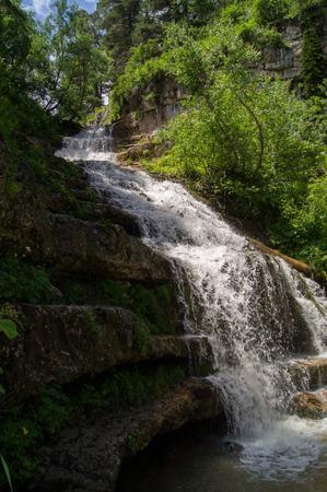 Falls in mountains of caucasus Stock Photo