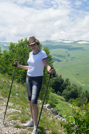 purposefulness: Woman hiker in the mountains of the Northwest Caucasus Stock Photo