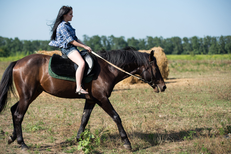 Young beautiful girl with a horse on nature Stock Photo