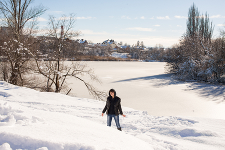 gentleness: Young girl walking in the winter