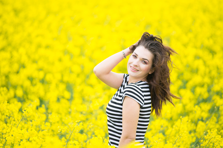 Portrait of a beautiful young girl on nature Stock Photo