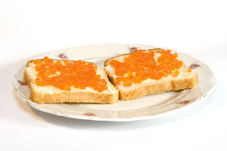 Two sandwiches with salmon caviar photo