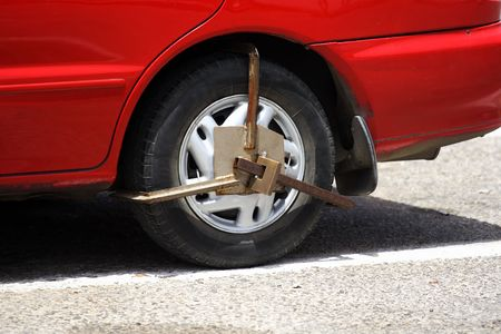 illegally: Wheel Clamp on illegally parked vehicle