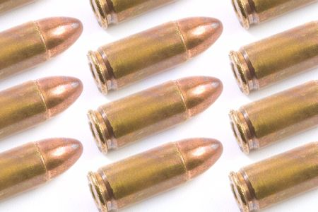 9mm bullets isolated on white background photo