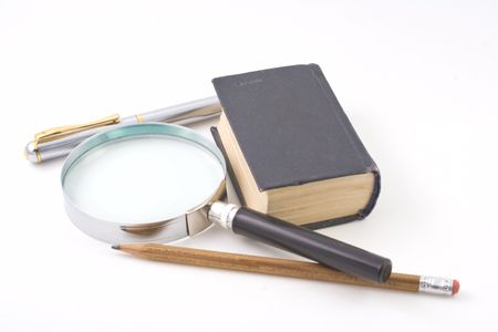 Old book and magnifying glass isolated on white background photo