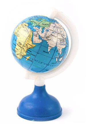 Small toy globe with Africa isolated on white  background photo