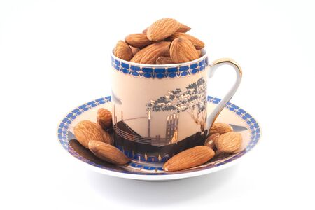 Coffee cup with almonds isolated on white background Stock Photo - 4043784