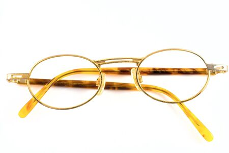 Old spectacles isolated on white background
