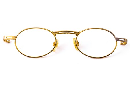 Old spectacles isolated on white background photo