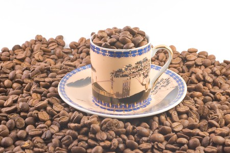 The fresh coffee beans in a cup photo