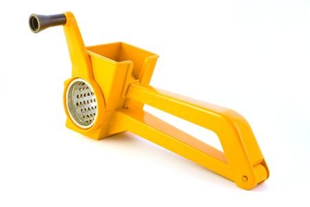 slicer: Orange vegetable slicer isolated on white background