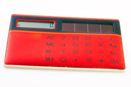 Red calculator isolated on white background photo