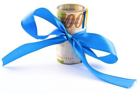 Israeli New Sheqel with blue ribbon on white background photo