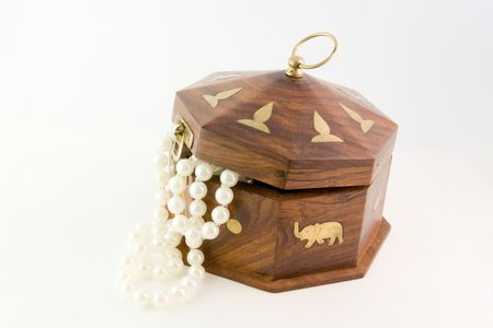 Wooden chest and necklace isolated on white background photo