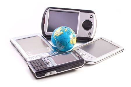 Gadgets and globe isolated on white background photo