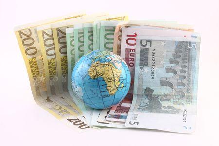 Globe on a Euro isolated on white background photo