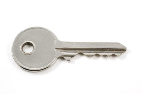 Small  key isolated on white background photo