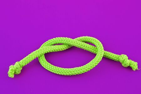bonding rope: Part of light green rope isolated on magentas background