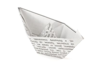 Newspaper ship isolated on white background photo