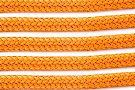 bonding rope: Parts of orange ropes isolated on white background