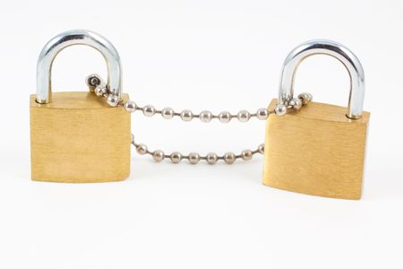 Two padlocks with chain isolated on white background photo