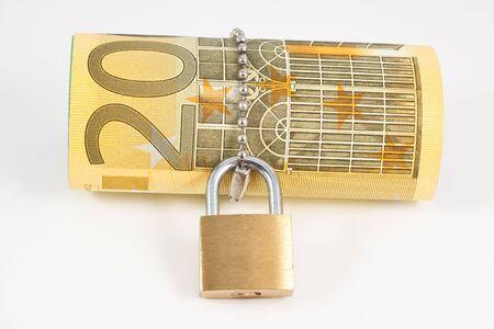 Euro with padlock isolated on white background photo