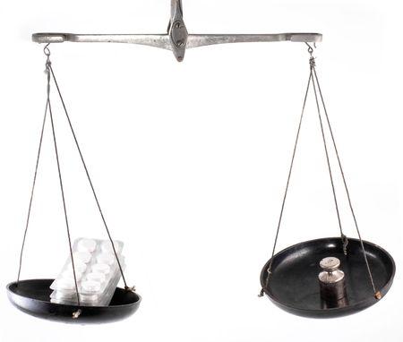 laboratory balance: Laboratory balance with pill isolated on white background