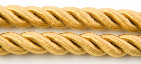 Golden rope isolated on white background Stock Photo