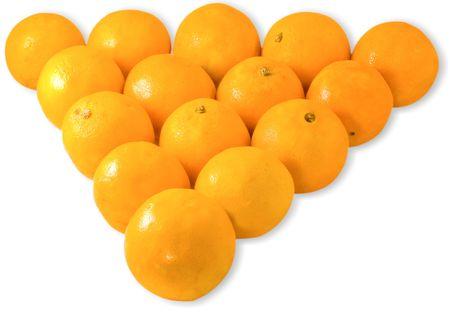 Pyramid of oranges isolated on white background photo