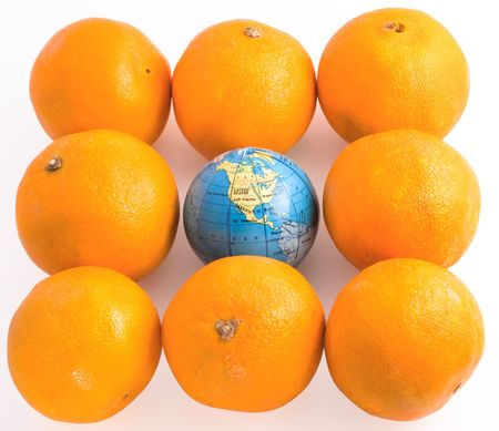 Oranges  with a toy globe isolated on white background photo