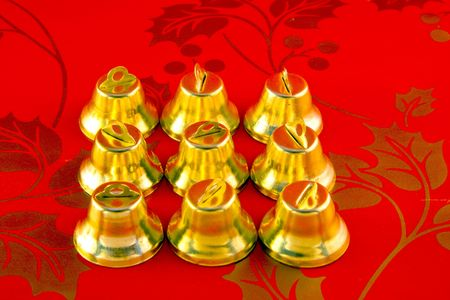 peal: Bells isolated on red background Stock Photo