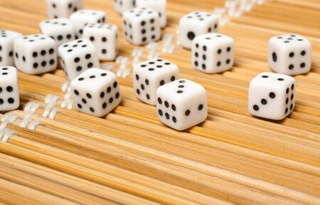Small dices isolated on the straw mat photo