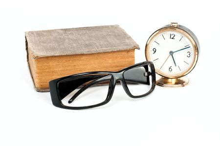 Glasses, clock, book isolated on white background photo