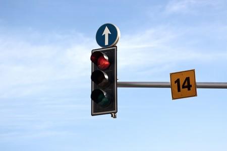 Traffic lights with straight arrow photo