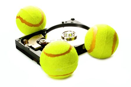 Hard disk with tennis balls isolated on white background Stock Photo - 6895177