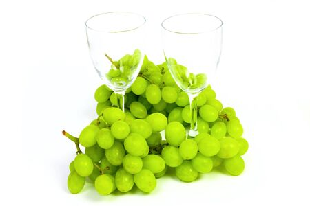sauternes: Wineglass and grape in crystal vase isolated on white background