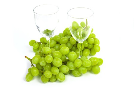 sauternes: Wineglass and grape with two goblets isolated on white background Stock Photo