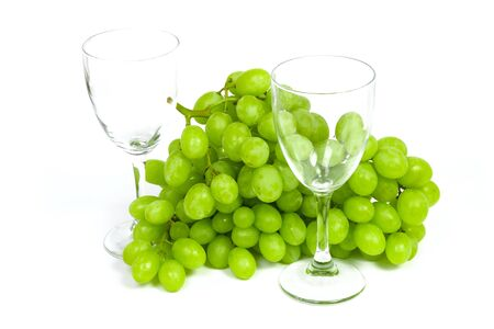 Wineglass and grape in crystal vase isolated on white background