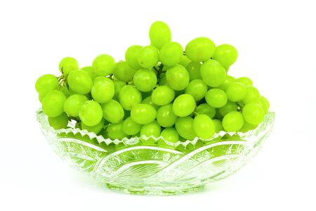 Grape in crystal vase isolated on white background Stock Photo