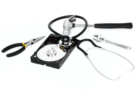 Hard disk with stethoscope and tools isolated on white background Stock Photo - 7557919