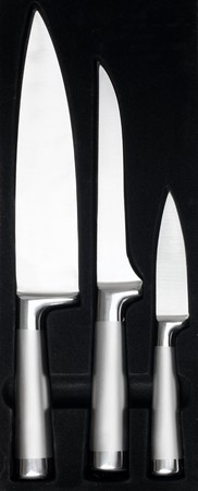 Kitchen knifes isolated in a black box photo