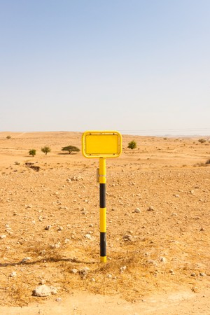 Yellow sign with in a desert photo