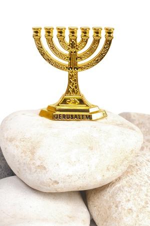 Menorah on a stone isolated on white background photo