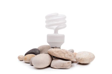 Electric lamp with stones isolated on white background photo