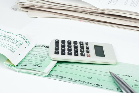 Checkbook, pen and calculator isolated on white background Imagens