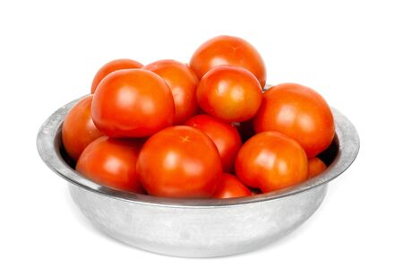 Tomatoes in a bowl isolated on white background photo