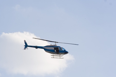 Flying helicopter on sky background photo