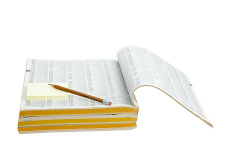 Phonebook with pen and sticker isolated on white background photo