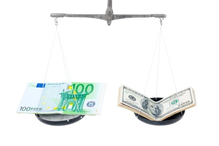 Money on balanced weight isolated on white background photo